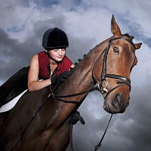 Female jockey riding horse